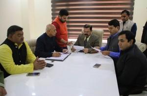 Ajay Nanda sitting